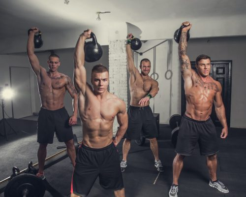 Four sporty muscular guys exercising.