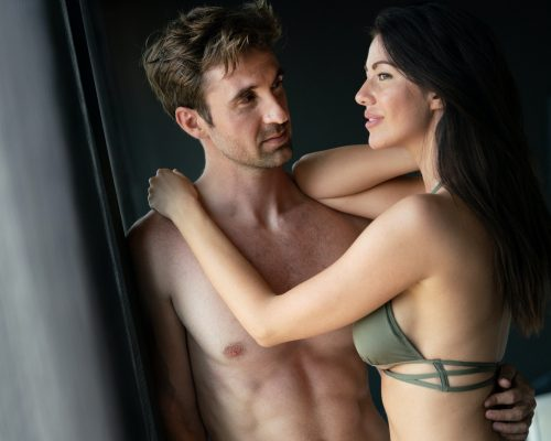 Sexy couple in love in bedroom, people, sex, sensual concept